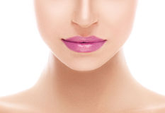 Beautiful woman pink lips close up studio on white Stock Photo