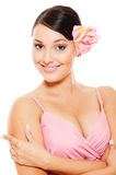 Beautiful woman with pink rose in hair Stock Photography