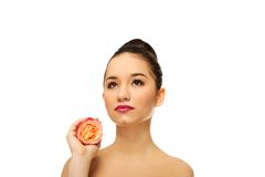 Beautiful woman with pink rose. Stock Image