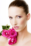 Beautiful woman with pink roses Stock Images