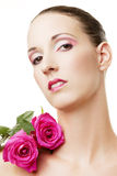 Beautiful woman with pink roses Royalty Free Stock Photography