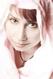 Beautiful woman in a pink shawl. Beautiful young woman in a pink shawl. Soft portrait of likable nice woman Stock Photos
