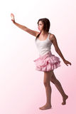 Beautiful woman in pink skirt, dancing Stock Image