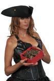 Beautiful Woman Pirate. Young beautiful pirate woman with treasure booty Stock Photography