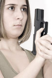 Beautiful woman with a pistol Royalty Free Stock Image