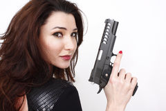 Beautiful woman with pistol stock image