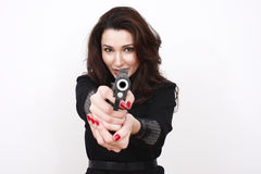 Beautiful woman with pistol. A beautiful woman holding a pistol safely with her finger off the trigger and the barrel pointed up Stock Photo