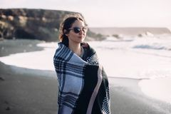 Beautiful woman in plaid enjoy ocean on the beach royalty free stock image