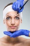 Beautiful woman with plastic surgery, depiction, plastic surgeon hands Stock Image