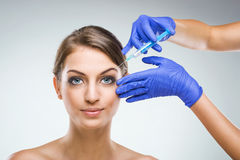 Beautiful woman with plastic surgery, plastic surgeon hands Royalty Free Stock Photography