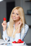 Beautiful woman with a plate of strawberries Stock Images