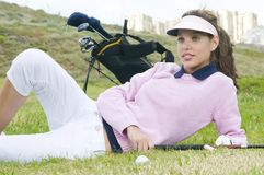 Beautiful Woman Player Lying On The Green Stock Images