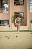 Beautiful  woman playing Boules game Royalty Free Stock Images