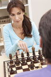 Beautiful Woman Playing Chess With Her Husband Royalty Free Stock Image