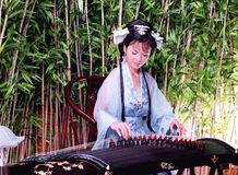 Beautiful woman playing Chinese Guzheng Stock Photography