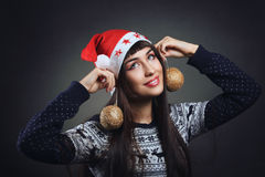 Beautiful woman playing with christmas decorations Royalty Free Stock Photography
