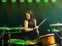 Beautiful woman playing drums onstage royalty free stock photos