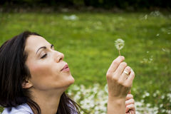 Beautiful woman playing with flowers Royalty Free Stock Photo