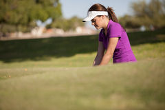 Beautiful woman playing golf Royalty Free Stock Photography