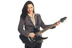 Beautiful woman playing guitar Stock Image