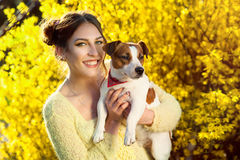 Beautiful woman playing with her dog. Outdoor portrait. series stock images