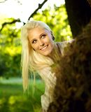 Beautiful woman playing hide and seek Royalty Free Stock Images