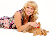 Beautiful woman playing with kitten Stock Photo