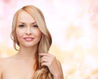 Beautiful woman playing with long hair Stock Photos