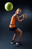 Beautiful woman playing padel indoor.  on black. Royalty Free Stock Photos
