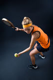Beautiful woman playing padel indoor.  on black. Stock Photos