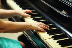 Beautiful woman playing piano,Close up of woman hands playing pi. Ano,Favorite classical music. Top view with dark vignette Stock Photo