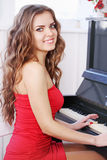 Beautiful woman playing the piano Stock Images