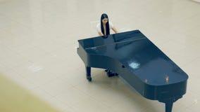 Beautiful woman playing the piano stock footage