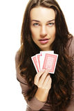 Beautiful woman playing poker Royalty Free Stock Photos