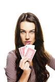 Beautiful woman playing poker Stock Images