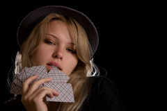 Beautiful woman playing poker royalty free stock images