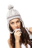 Beautiful woman playing with the pompom of her win Royalty Free Stock Images