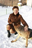 Beautiful woman playing with shepherd dog Stock Images