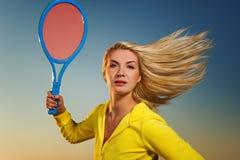 Beautiful woman playing tennis Stock Photography