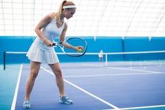 Beautiful Woman Playing Tennis royalty free stock image
