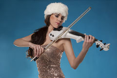 Beautiful woman playing a violin against blue sky Royalty Free Stock Images
