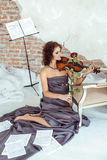 Beautiful woman playing the violin bow rose Stock Photos