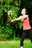Beautiful woman playing volleyball Royalty Free Stock Images