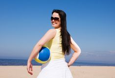 Beautiful woman playing volleyball at the beach Stock Image