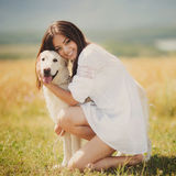 Beautiful woman plays with the dog on the Meadow Royalty Free Stock Photography