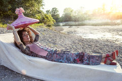 Beautiful woman plays with her straw hat Stock Image