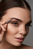 Beautiful Woman Plucking Eyebrows. Beauty Brows Correction Royalty Free Stock Photos