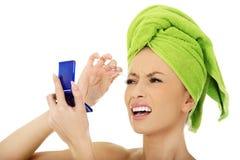 Beautiful woman plucking her eyebrow. Royalty Free Stock Photo