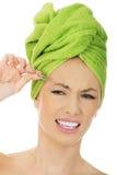 Beautiful woman plucking her eyebrow. Stock Image