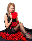 Beautiful woman  with a plush toy and the heart Royalty Free Stock Image